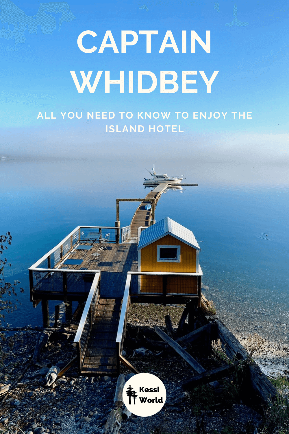 This Pinterest tile shows the dock at Captain Whidbey, which projects into Penn Cove, which in this morning view has fog fading off into the horizon. There is a yellow boat house with white trim on the top larger dock structure and the sky is a bright blue.