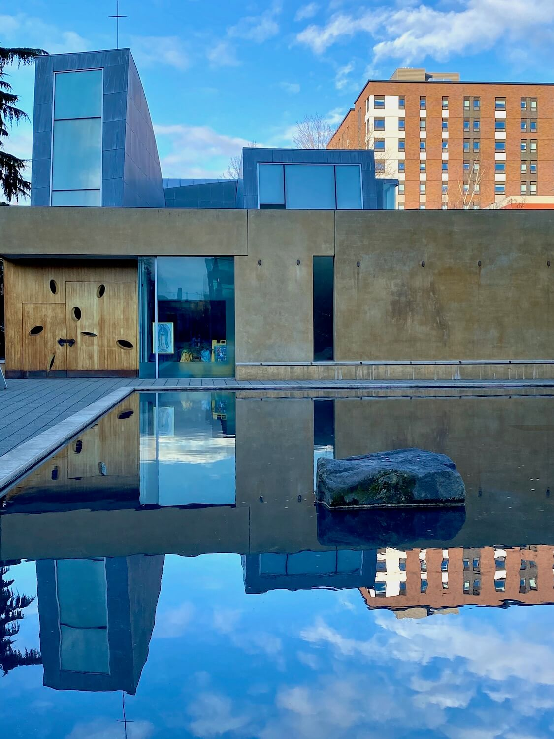 The Chapel of St. Ignatius on the campus of Seattle University offers a unique architecture with a variety of geometrical shapes towering over a rectangular reflection pool.