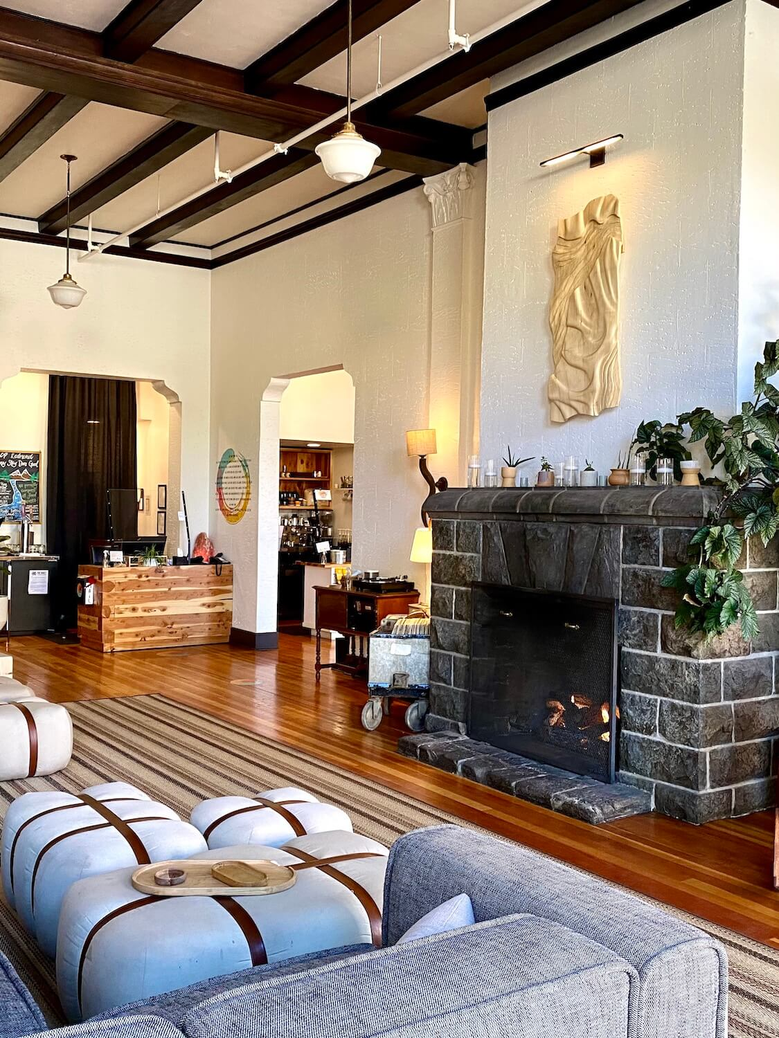 The lobby of the SCP Hotel Redmond combines historic features with hip furnishings amongst a large stone fireplace and comfy overstuffed couches.  This hotel makes for a great place to stay while on a weekend getaway to Central Oregon.