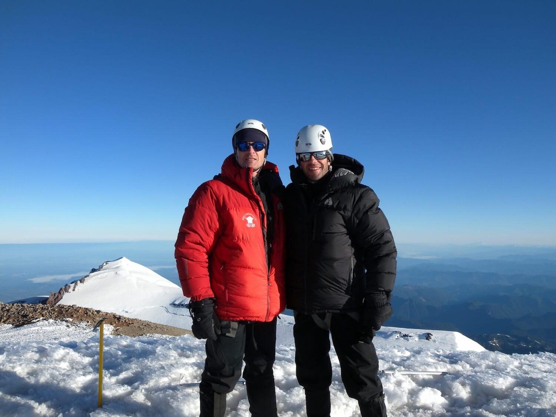 Matthew Kessi and friend stand at the summit of Mt. Rainier