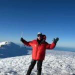 Matthew Kessi stands at the summit of Mt. Rainier