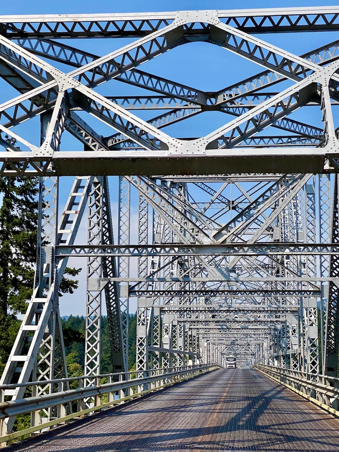 The metal structure of the bridge of the gods connects Cascade Locks, Oregon with Stevenson, Washington. This is the road trip itinerary to Spirit Lake on Mount St. Helens.
