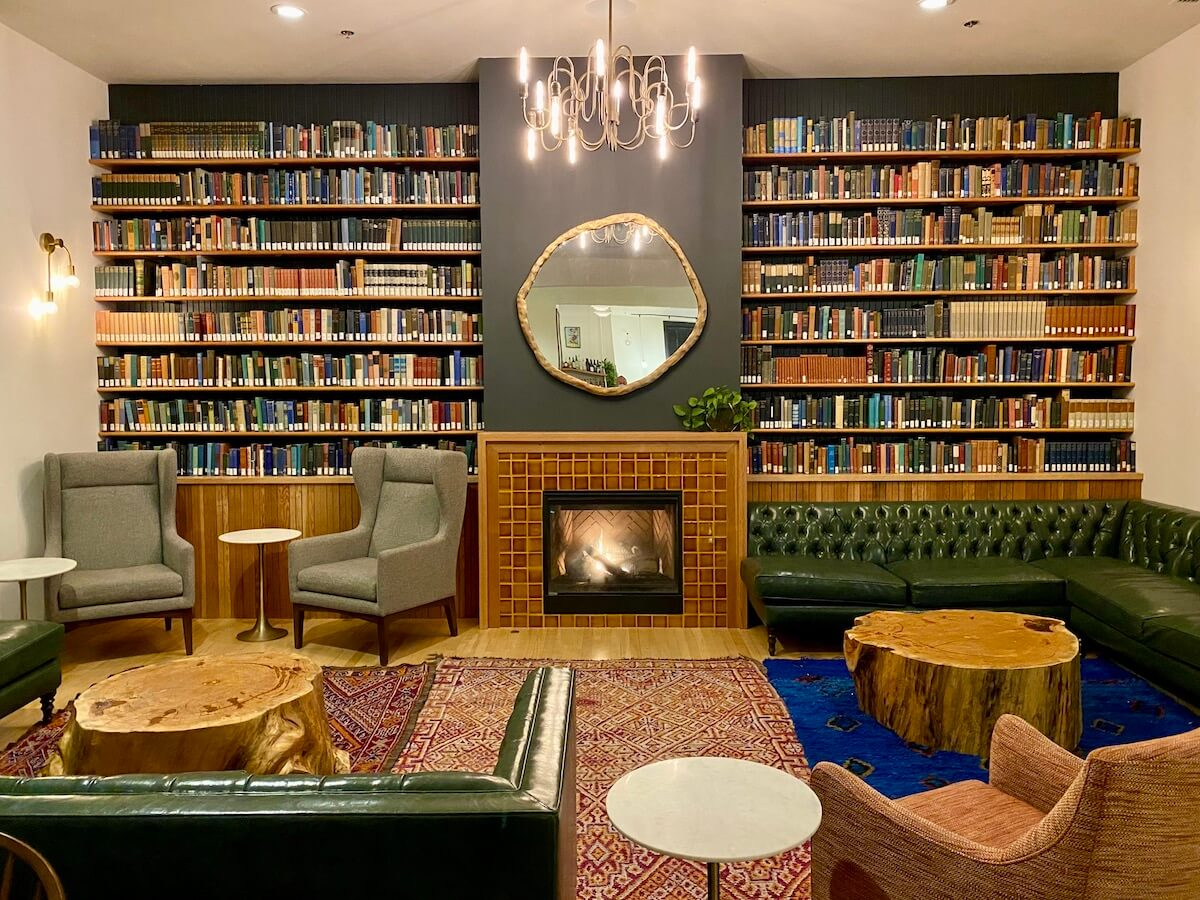 The lobby of the Society Hotel is a cozy place to sit and read. There is afire roaring and shelves of books. Comfortable looking couches and chairs are strategically placed throughout the room.