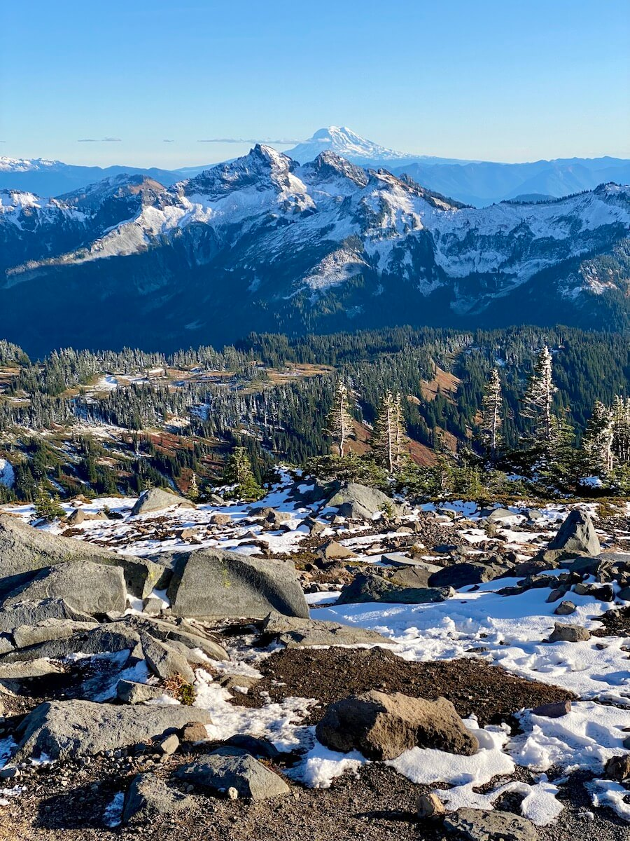 A view from Panorama Peak on Mt. Rainier shows Mt. Adams in the distance as well as other lower Cascade Mountain peaks.